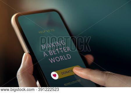 Online Donation, Volunteer And Charity Concept. Woman Making Donate Via Internet On Mobile Phone. Cl