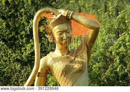 Golden Sculpture Of The Goddess Niin Kon Khin Hor'ni In A Buddhist Monastery