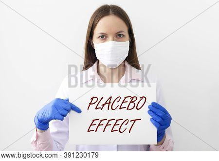 Placebo Effect Concept Inscription. Serious Doctor In Mask And Gloves.