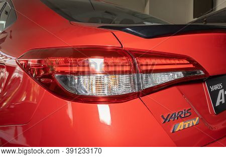 Phayao, Thailand - Sep 13, 2020: Left Taillight Or Tail Lamp Of Red Yaris Ativ 2020 In Car Dealershi