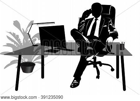 Silhouette Of Businessman Talking On The Phone At His Desk