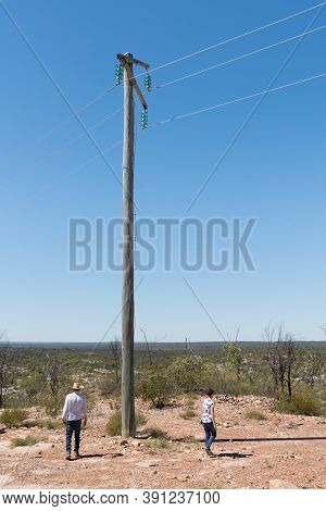 Tourists Near Power Pole At Sawpit Gorge In White Mountains National Park, Queensland