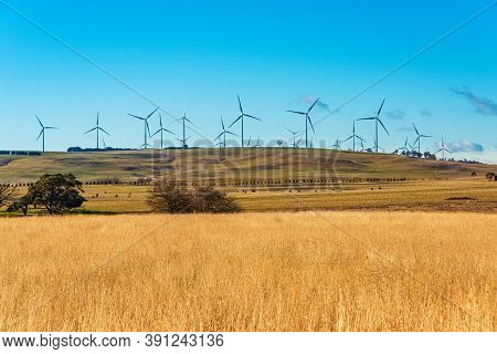 Power Plant With Wind Turbine In Wind Farm, Clean Energy Generator. Wind Turbine Generating Electric