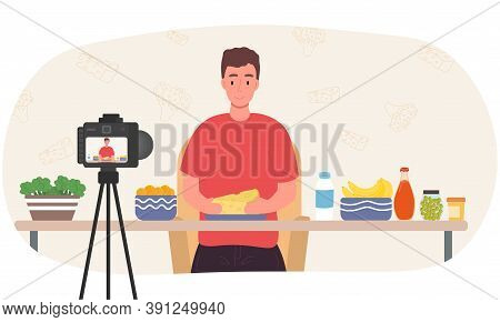 A Male Video Blogger Is Filming A Video About How He Cooks And Eats Healthy And Fresh Food. Flat Car