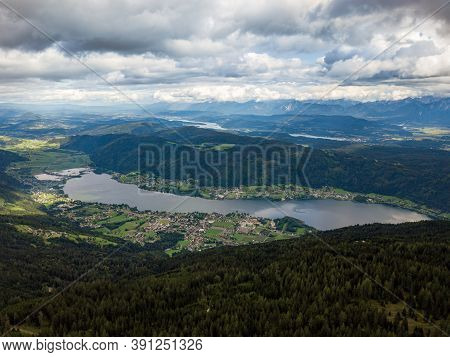 Aerial Drone View On Ossiacher Lake In Carinthia, Austria On A Summer Day With Great Cloudscape And
