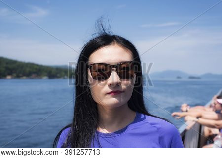 A Chinese Woman Standing On The Deck Of A Steamboat Traveling On Lake George New York On A Sunny Sum