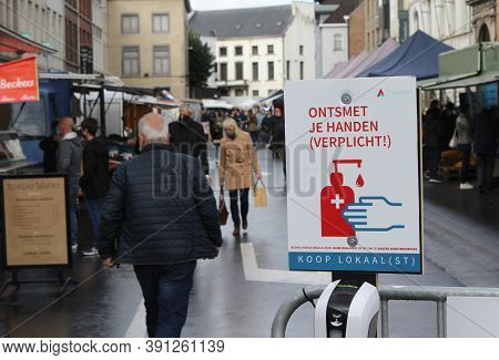 Aalst, Belgium 24 October 2020: 'mandatory Hand Disinfection' Signs At The Entrance To The Weekly Lo