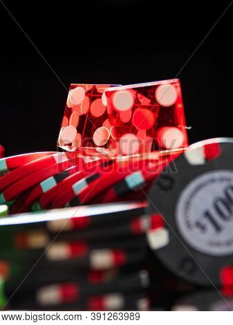 Casino Craps dice and chips close up - Shallow depth of field