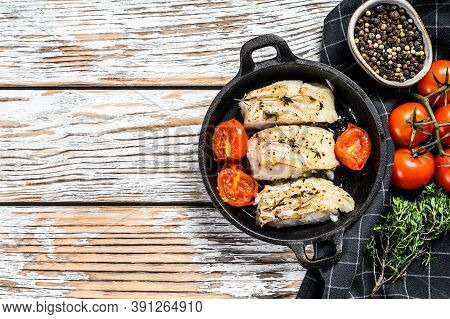 Grilled Pollock Or Coalfish Fillets In A Pan. White Background. Top View. Copy Space