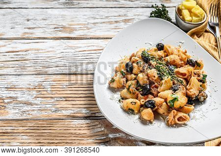 Conchiglie Rigate Italian Pasta With Tomato, Olives, Capers, Anchovies. White Background. Top View.