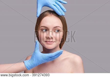 Doctor Hands In Protective Medical Gloves. Derma Test. Prepare Operation Consultation. Pretty Young