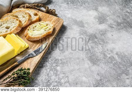Farm Butter And Fresh Baguette With Butter. Gray Background.top View. Copy Space