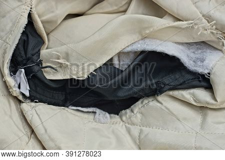A Piece Of Cloth On White Old Torn Clothes With A Big Black Hole