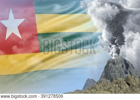 Volcano Blast Eruption At Day Time With White Smoke On Togo Flag Background, Problems Of Eruption An