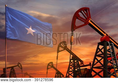 Somalia Oil Industry Concept, Industrial Illustration. Somalia Flag And Oil Wells And The Red And Bl