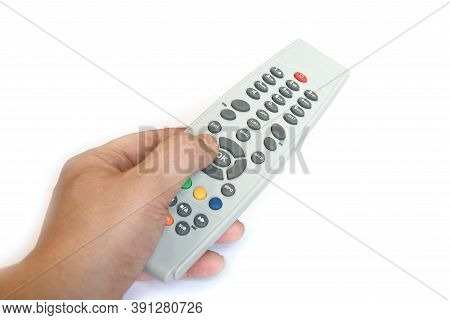 Male Hand Changing Channel With Remote Control Isolated