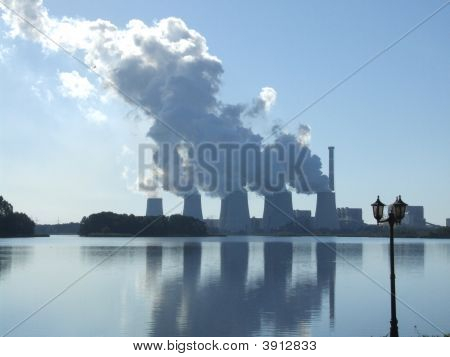 Power Station Reflecting In Sea