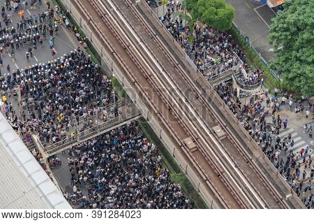 Aerial Top View Of Flash Mobs Protesters Demonstration Rally On Street Road Against Government, Crow