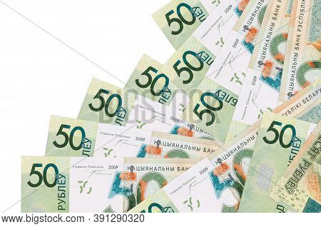 50 Belorussian Rubles Bills Lies In Different Order Isolated On White. Local Banking Or Money Making