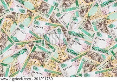 10 Sri Lankan Rupees Bills Lies In Big Pile. Rich Life Conceptual Background