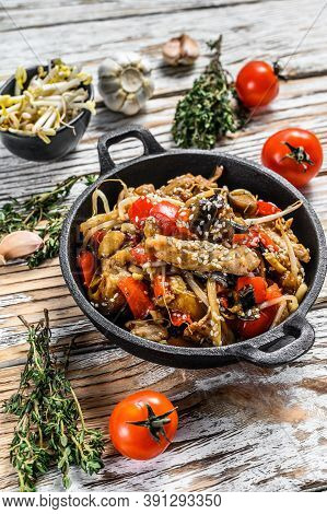 Chicken Stir-fry In A Pan. Wok Udon Noodles. Traditional Asian Food. White Background. Top View