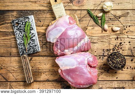 Raw Boneless Turkey Thigh Fillet On A Chopping Board. Wooden Background. Top View