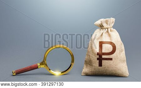 Russian Ruble Money Bag And Magnifying Glass. Most Favorable Conditions For Deposits, Loans. Origin