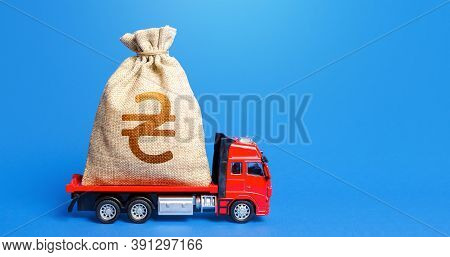 Truck Is Carrying A Big Ukrainian Hryvnia Money Bag. Attracting Large Funds To The Economy For Subsi