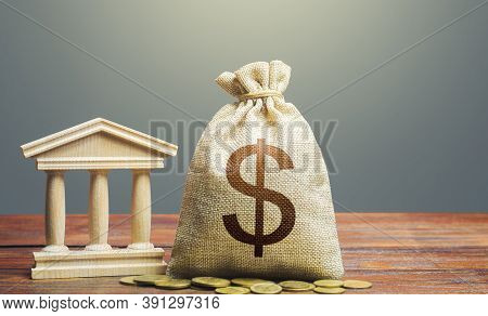Dollar Money Bag And Bank / Government Building. Tax Collection And Budgeting. State Debt. Gdp And G
