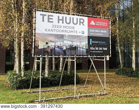 Almere, Flevoland, The Netherlands - Oktober 24, 2020: Dutch Billboard Sign Advertising For Office R