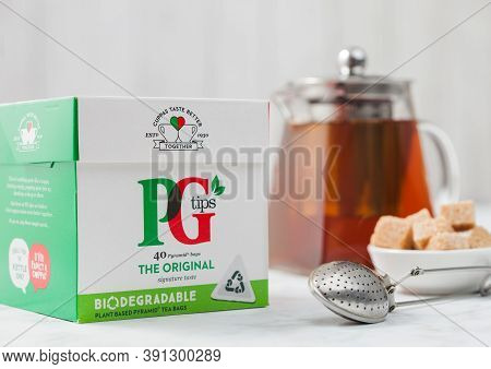 London, Uk - October 21, 2020: Pack Of Pg Tips Black Tea With Teapot And Cane Sugar On White With Vi
