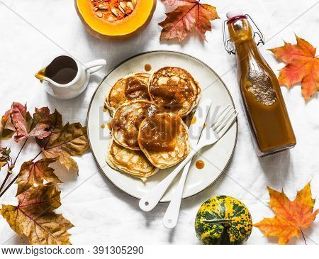 Pancakes With Homemade Pumpkin Syrup On A Light Background, Top View. Delicious Breakfast, Brunch