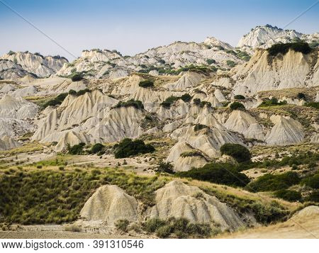 Dramatic View Of Aliano Badlands (calanchi), Lunar Landscape Made Of Clay Sculptures Eroded By The R