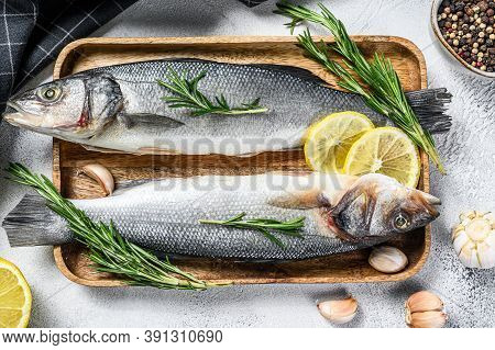 Sea Bass Fish With, Raw Sea Bass. Black Background. Top View
