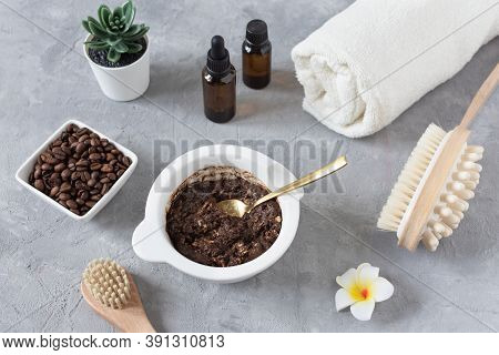 Homemade Body Scrub Made With Ground Coffee, Honey And Oatmeal In A Jar On Gray Concrete Table.