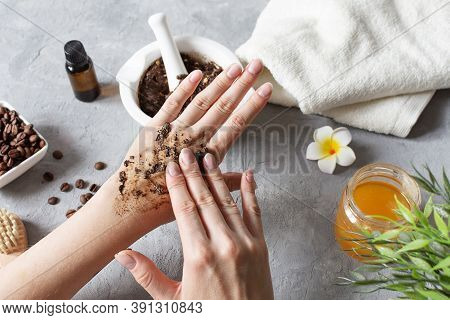 Woman Hands Making Peeling With Homemade Body Scrub Made With Ground Coffee, Honey And Oatmeal Over