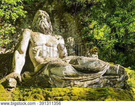 Colossal Sculpture Of God Neptune At Famous Park Of The Monsters, Also Named Sacred Grove, Bomarzo G