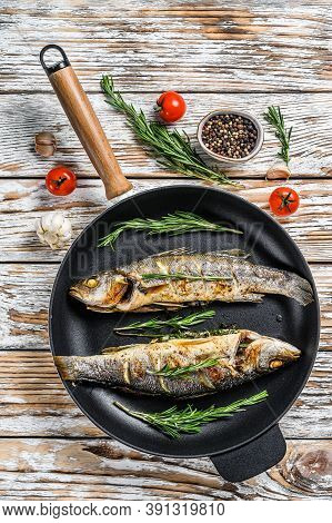 Bbq Sea Bass Fish, Fried Sea Bass In A Pan. White Wooden Background. Top View