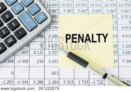Penalty Text On Yellow Card Next To Pen And Calculator