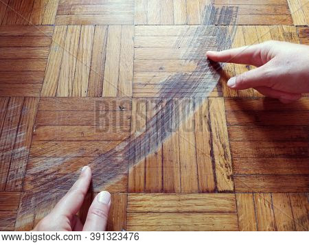 Old, Scratched Parquet Flooring Needs Maintenance. The Parquet Is Damaged By Scratches From Prolonge