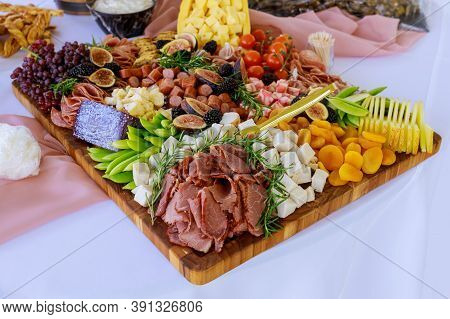 Party Table. Variety Or Assortment Of Cheese, Fruits And Deli.