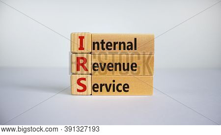 Concept Word 'irs - Internal Revenue Service' On Wooden Cubes And Blocks On A Beautiful White Backgr