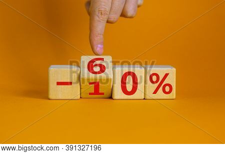 Hand Turns A Cube And Changes The Expression '-10 Percent' To '-60 Percent'. Beautiful Orange Backgr