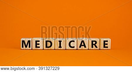 Wooden Cubes With Word 'medicare'. Beautiful Orange Background. Medical Concept. Copy Space.