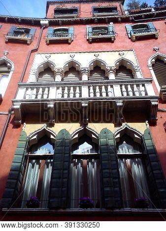 Venice, Italy. May 30, 2020. Facade Of A Beautiful Venetian Building. The Palace Has Pink Walls, Man