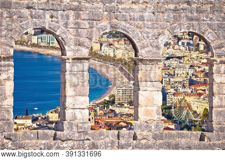 City Of Nice And Promenade Des Anglais Waterfront Aerial View Through Stone Windows, French Riviera,