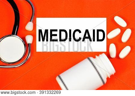 Medicaid. Text Inscription On The Background Of Medicines. The State Program Covers Medical Expenses