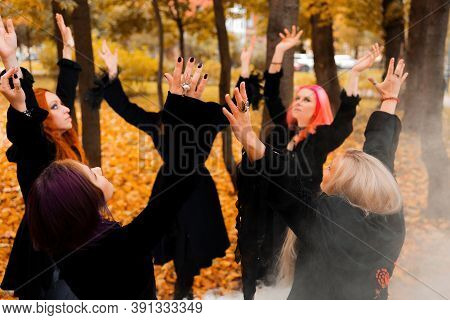 Coven Of Witches, A Group Of Friends As Witches On Halloween Perform A Ritual, Lead A Round Dance An
