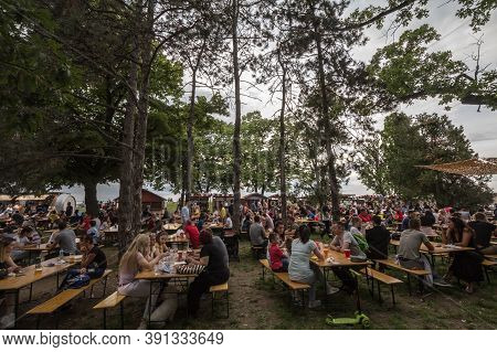 Belgrade, Serbia - May 26, 2019: Crowd Of Serbs Sitting And Drinking Beer In A Beergarden In Spring