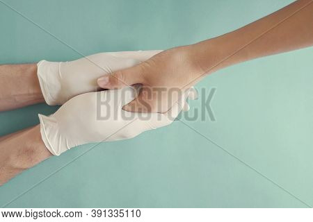 Hands With Gloves Holding Child Hand, Helping Hands, Compassion, Donation, Volunteer And Charity Con